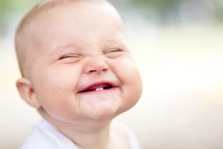 A baby smiles | Children's Dentistry Raymond NH