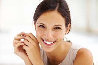 A woman smiles | candia NH cosmetic dentist